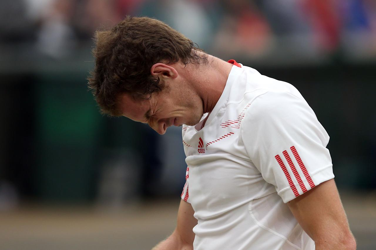 LONDON, ENGLAND - JULY 08:  Andy Murray of Great Britain reacts during his Gentlemen's Singles final match against Roger Federer of Switzerland on day thirteen of the Wimbledon Lawn Tennis Championships at the All England Lawn Tennis and Croquet Club on July 8, 2012 in London, England.  (Photo by Julian Finney/Getty Images)