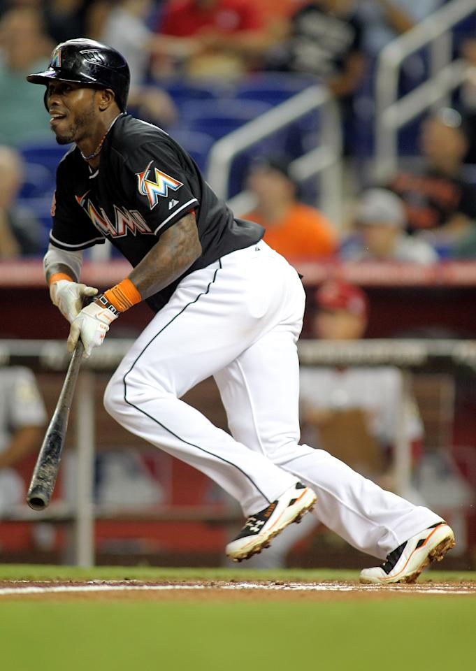 MIAMI, FL - APRIL 13: Jose Reyes #7 of the Miami Marlins gets a hit against the Houston Astros at Marlins Park on April 13, 2012 in Miami, Florida.  (Photo by Marc Serota/Getty Images)
