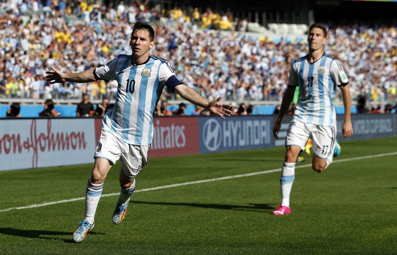 Argentina's Lionel Messi, left, celebrates after scoring during the group F World Cup soccer match between Argentina and Iran at the Mineirao Stadium in Belo Horizonte, Brazil, Saturday, June 21, 2014. (AP Photo/Jon Super)