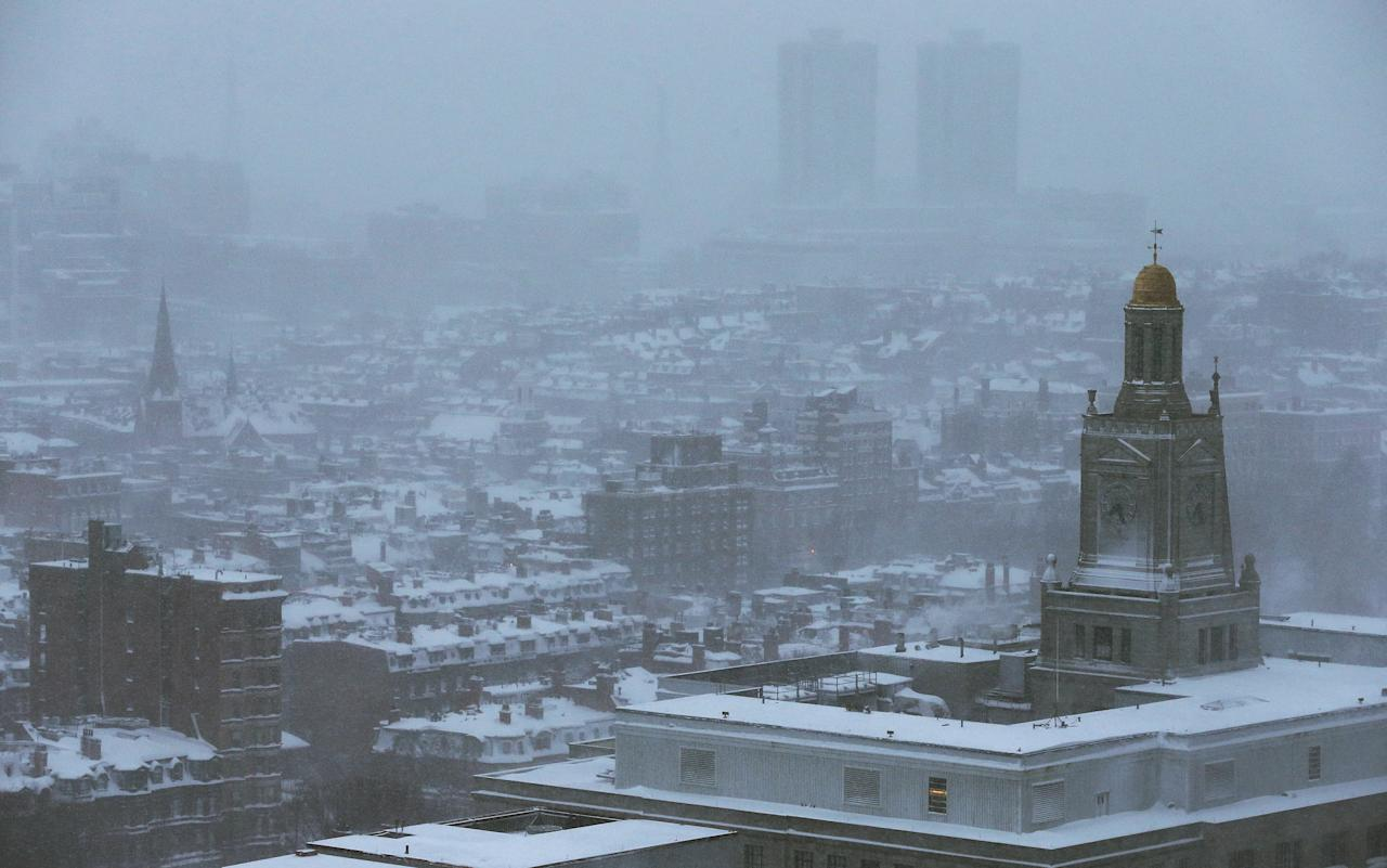 BOSTON, MA - FEBRUARY 09: Snow blankets the city during a lingering blizzard on February 9, 2013 in Boston, Massachusetts. The powerful storm has knocked out power to 650,000 and dumped more than two feet of snow in parts of New England.  (Photo by Mario Tama/Getty Images)