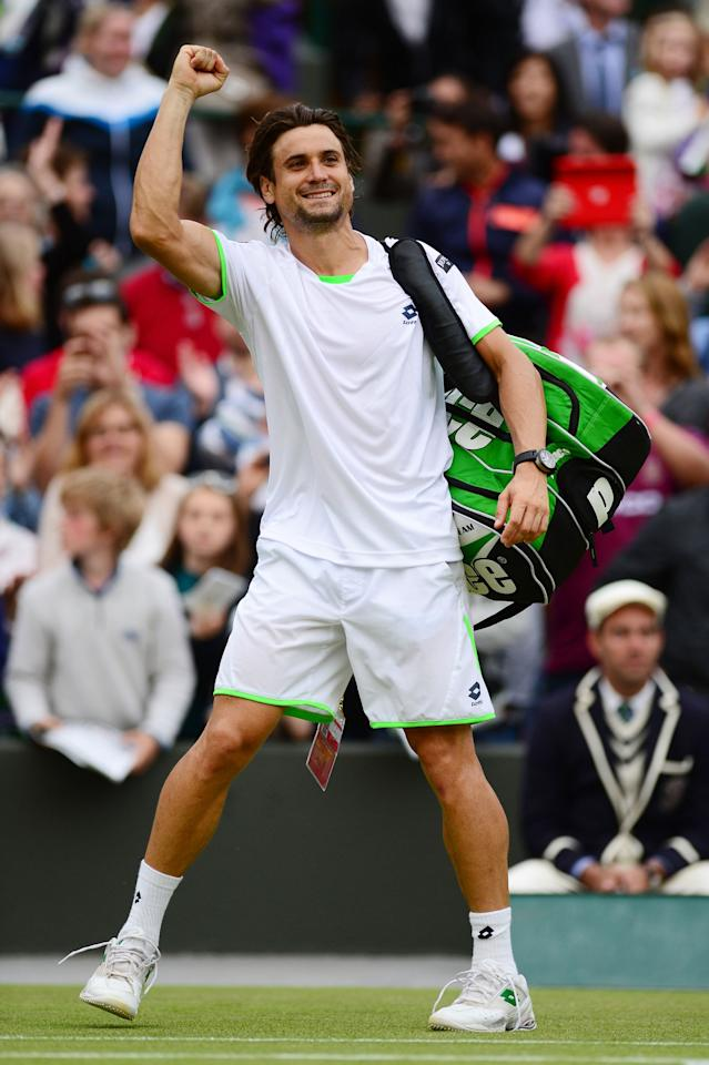 LONDON, ENGLAND - JUNE 29: David Ferrer of Spain celebrates victory during the Gentlemen's Singles third round match against Alexandr Dolgopolov of Ukraine on day six of the Wimbledon Lawn Tennis Championships at the All England Lawn Tennis and Croquet Club on June 29, 2013 in London, England. (Photo by Mike Hewitt/Getty Images)