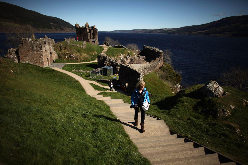 SCOTLAND:  Tourists visit Urquhart Castle on Loch Ness in Drumnadrochit, Scotland, United Kingdom.