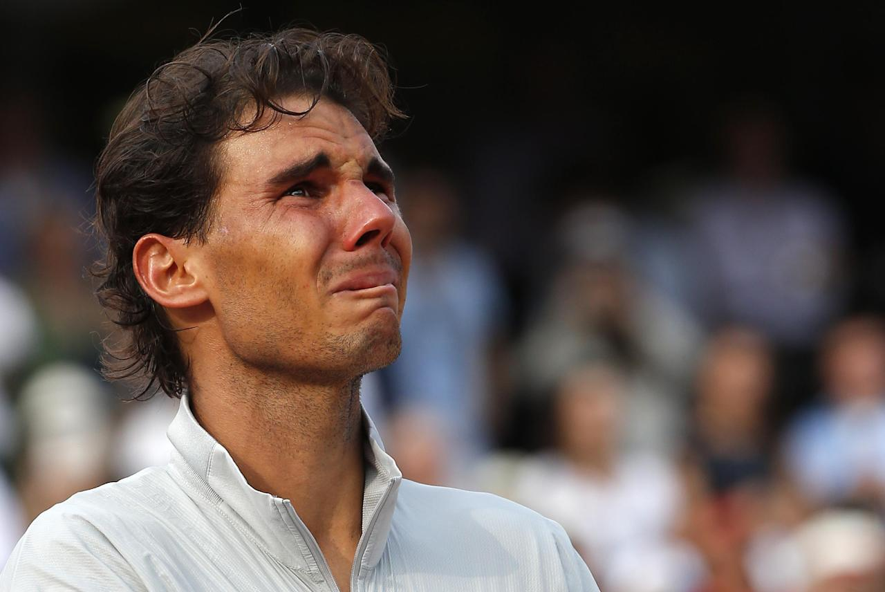 Spain's Rafael Nadal reacts on the podium after defeating Serbia's Novak Djokovic in their final match of the French Open tennis tournament at the Roland Garros stadium, in Paris, France, Sunday, June 8, 2014. Nadal won 3-6, 7-5, 6-2, 6-4. (AP Photo/Michel Euler)