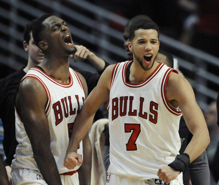 Bobby Portis and Michael Carter Williams celebrate the Bulls' luck. More