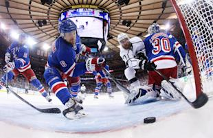 Rangers defenseman Anton Stralman reaches to save the puck from crossing the goal line as Kings center Jeff Carter tries to score in the first period during Game 4 of the Stanley Cup Final on June 11, 2014, in New York. (AP)