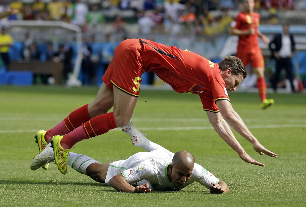 Algeria's Sofiane Feghouli is brought down by Belgium's Jan Vertonghen to get a penalty during the group H World Cup soccer match between Belgium and Algeria at the Mineirao Stadium in Belo Horizonte, Brazil, Tuesday, June 17, 2014.  (AP Photo/Ricardo Mazalan)
