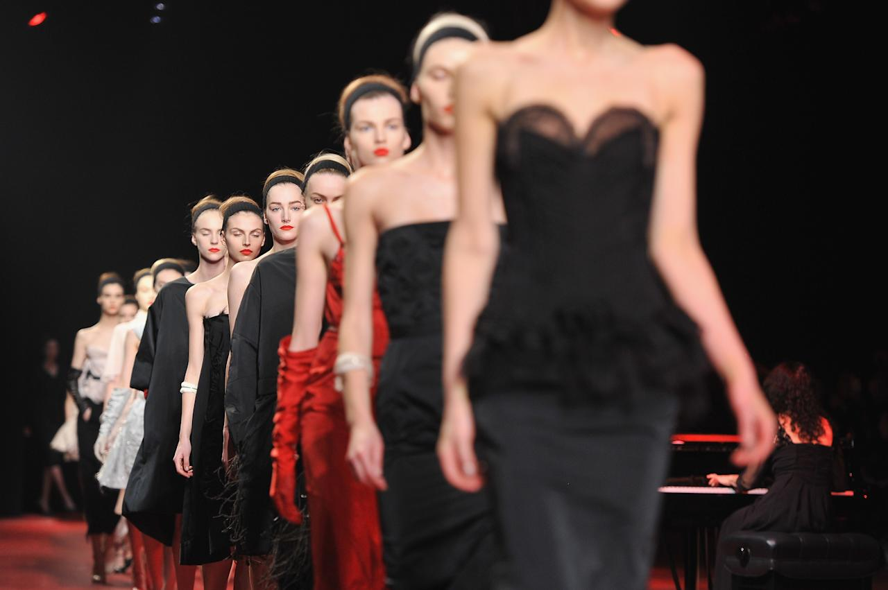PARIS, FRANCE - FEBRUARY 28:  Models walk the runway during the Nina Ricci Fall/Winter 2013 Ready-to-Wear show as part of Paris Fashion Week on February 28, 2013 in Paris, France.  (Photo by Pascal Le Segretain/Getty Images)
