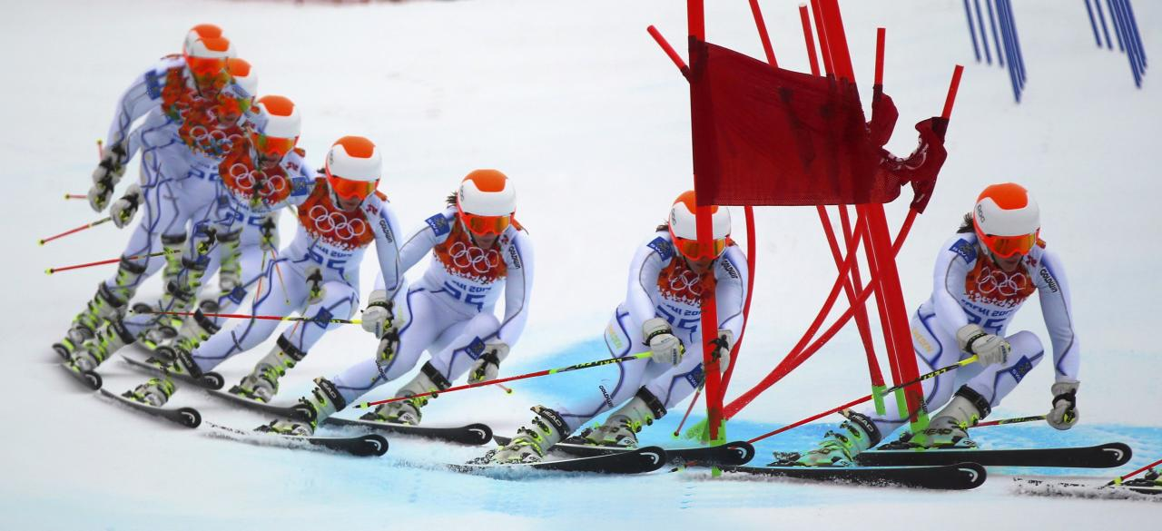Sweden's Kajsa Kling clears a gate during the second run of the women's alpine skiing giant slalom event at the 2014 Sochi Winter Olympics at the Rosa Khutor Alpine Center February 18, 2014. Picture taken with multiple exposure function. REUTERS/Dominic Ebenbichler (RUSSIA - Tags: SPORT SKIING OLYMPICS)