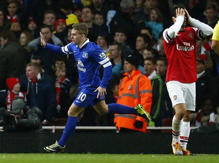 Everton's Deulofeu celebrates scoring during their English Premier League soccer match against Arsenal at The Emirates in London