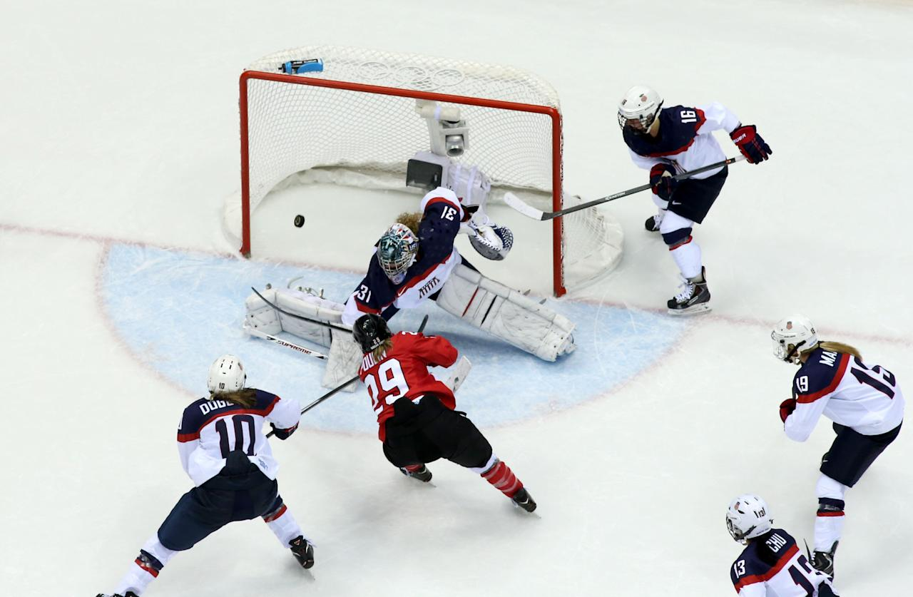 SOCHI, RUSSIA - FEBRUARY 20: Marie-Philip Poulin #29 of Canada scores a third-period goal against Jessie Vetter #31 of the United States during the Ice Hockey Women's Gold Medal Game on day 13 of the Sochi 2014 Winter Olympics at Bolshoy Ice Dome on February 20, 2014 in Sochi, Russia. (Photo by Bruce Bennett/Getty Images)