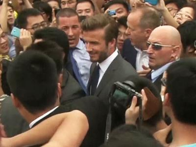 Fans eager to see soccer superstar David Beckham stormed a police cordon on Thursday in a stampede at a Shanghai university that injured seven people including five security personnel. (June 20)