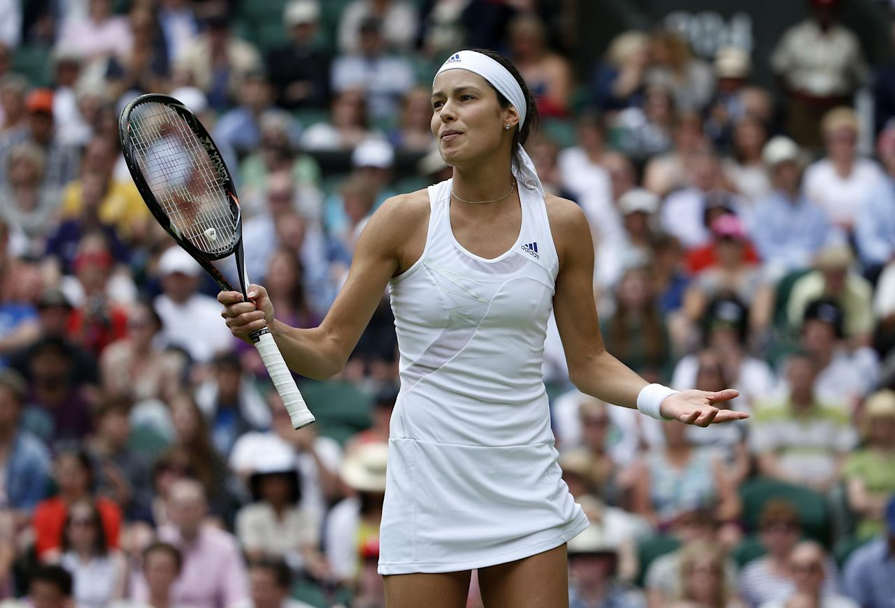 Serbia's Ana Ivanovic reacts in her match against Canada's Eugenie Bouchard during day Three of the Wimbledon Championships at The All England Lawn Tennis and Croquet Club, Wimbledon.