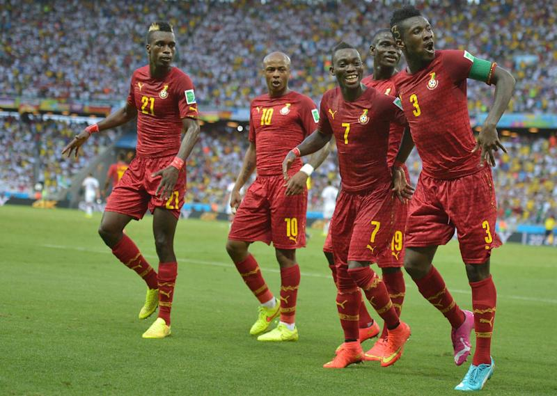 Ghana forward and captain Asamoah Gyan (R) celebrates with teammates after scoring during the World Cup Group G match against Germany at the Castelao Stadium in Fortaleza on June 21, 2014
