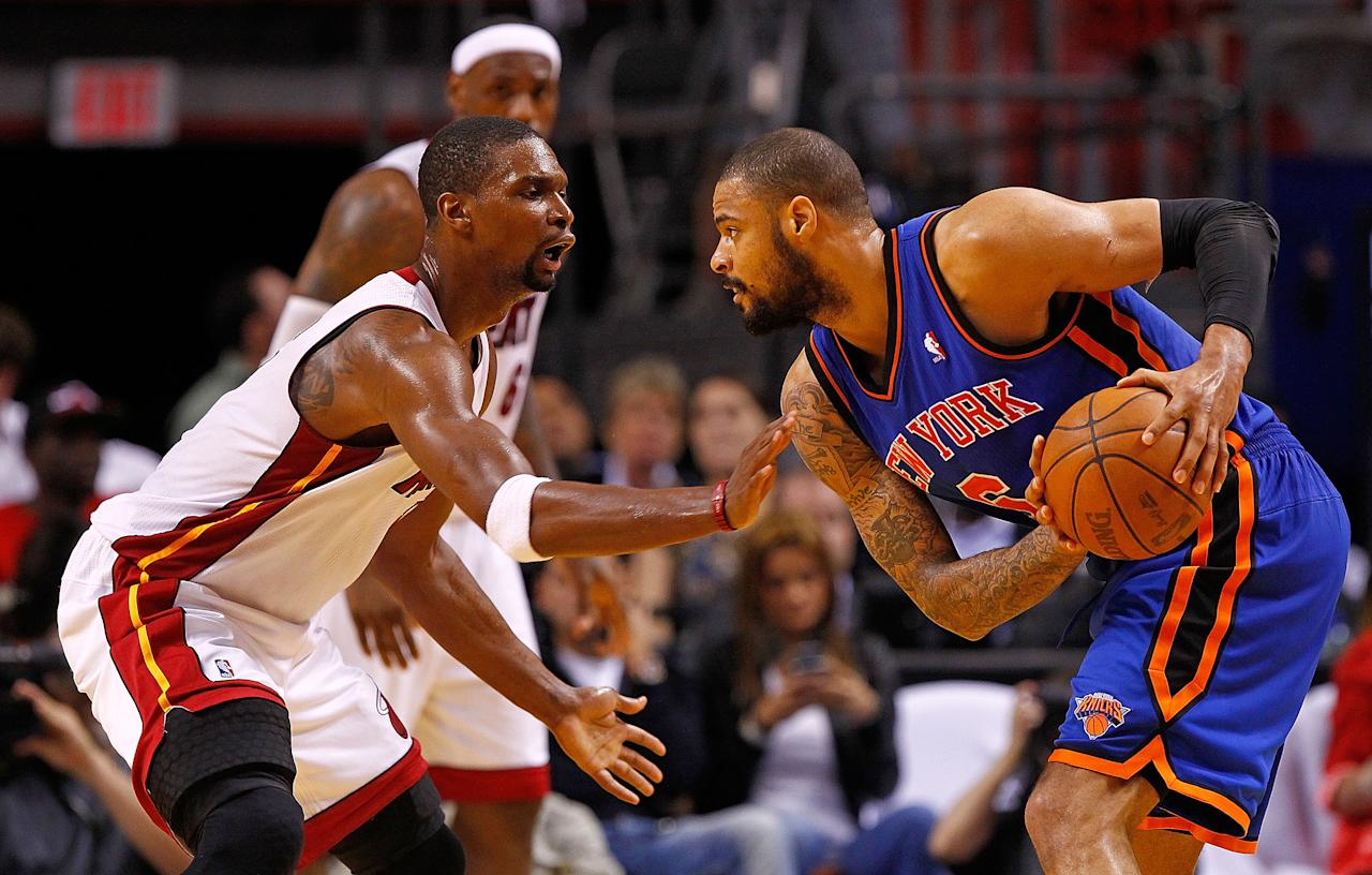MIAMI, FL - APRIL 30: Tyson Chandler #6 of the New York Knicks posts up Chris Bosh #1 of the Miami Heat during Game Two of the Eastern Conference Quarterfinals in the 2012 NBA Playoffs  at American Airlines Arena on April 30, 2012 in Miami, Florida. NOTE TO USER: User expressly acknowledges and agrees that, by downloading and/or using this Photograph, User is consenting to the terms and conditions of the Getty Images License Agreement.  (Photo by Mike Ehrmann/Getty Images)