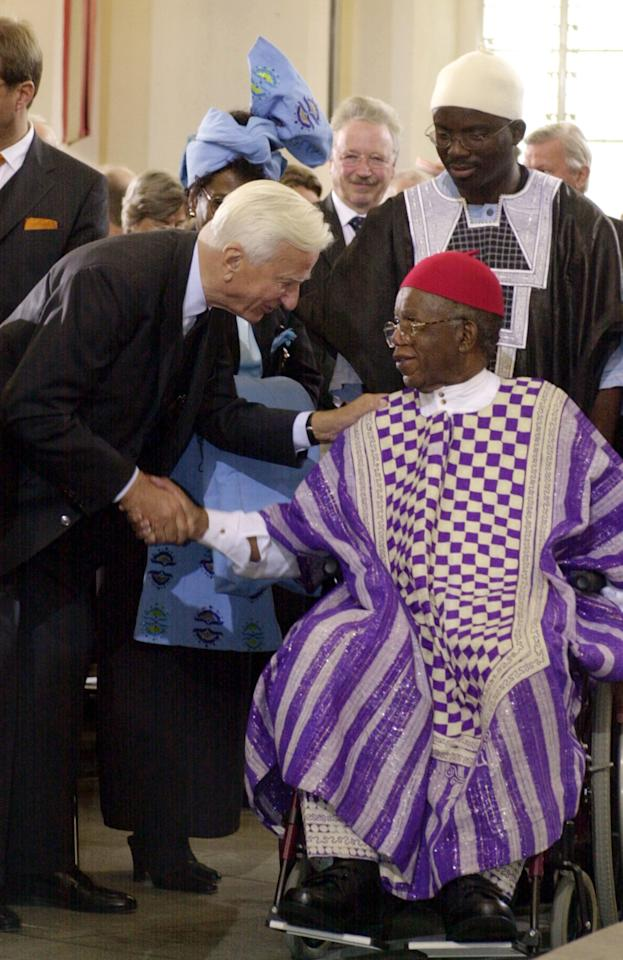 """FILE - In this Oct. 13, 2002 file photo, Richard von Weizaecker, left, former German President, congratulates Nigerian author Chinua Achebe, after Achebe was awarded the prestigious Peace Prize of the German publishing industry at the Paul's Church in Frankfurt Main, Germany. Achebe, who wrote the classic, """"Things Fall Apart,"""" has died. He was 82. Achebe's publisher confirmed his death Friday, March 22, 2013. (AP Photo/dpa, Frank May, File)"""