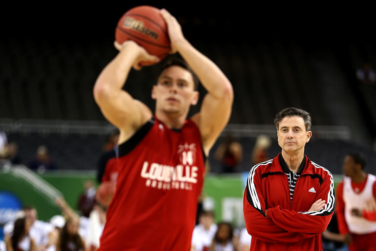 NEW ORLEANS, LA - MARCH 30:  (R) Head coach Rick Pitino of the Louisville Cardinals watches as Kyle Kuric #14 shoots the ball during practice prior to the 2012 Final Four of the NCAA Division I Men's Basketball Tournament at the Mercedes-Benz Superdome on March 30, 2012 in New Orleans, Louisiana.  (Photo by Jeff Gross/Getty Images)