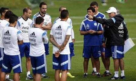 Argentina's coach Sabella gestures as he talks to players during a training session ahead of their 2014 World Cup final match against Germany in Vespasiano
