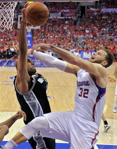 San Antonio Spurs' Tim Duncan, left, blocks the shot of Los Angeles Clippers' Blake Griffin during the second half in Game 3 of an NBA basketball playoffs Western Conference semifinal, Saturday, May 19, 2012, in Los Angeles. The Spurs won 96-86. (AP Photo/Mark J. Terrill)
