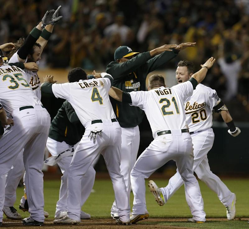 A's agree to 10-year lease to stay in Oakland