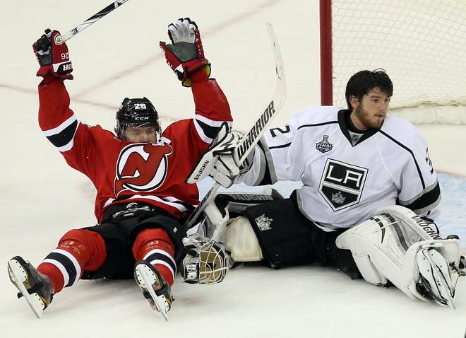 NEWARK, NJ - JUNE 02: Patrik Elias #26 of the New Jersey Devils collides with Jonathan Quick #32 of the Los Angeles Kings during Game Two of the 2012 NHL Stanley Cup Final at the Prudential Center on June 2, 2012 in Newark, New Jersey.  (Photo by Jim McIsaac/Getty Images)