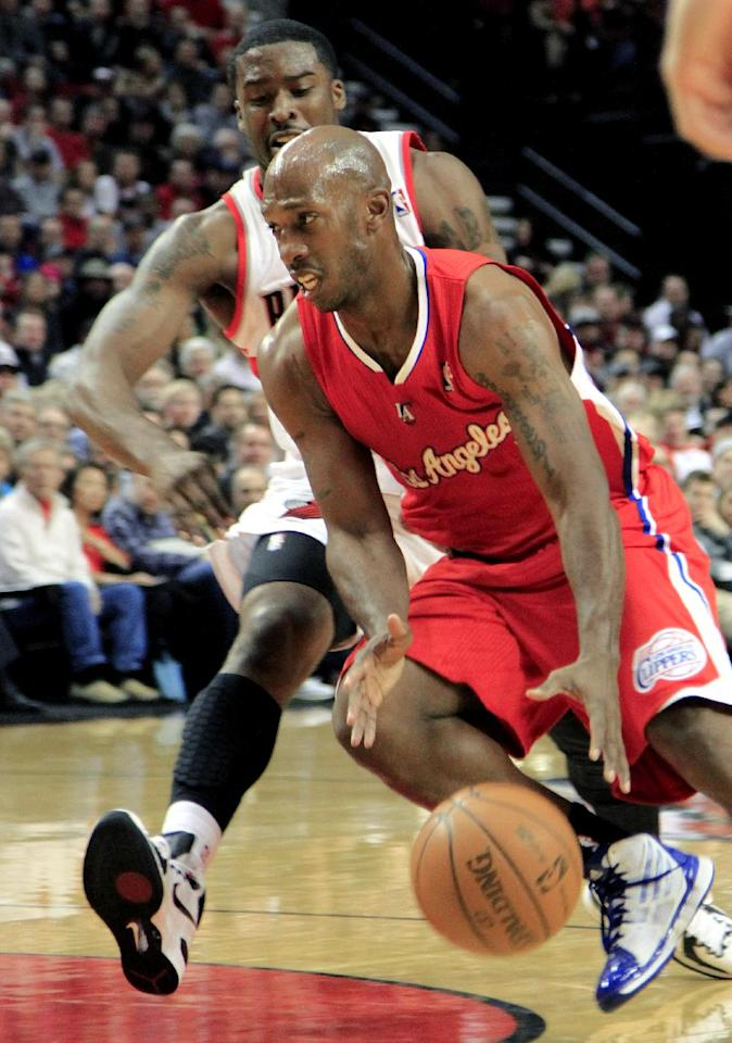 Los Angles Clippers guard Chauncey Billups, right, drives to the basket against Portland Trail Blazers guard Wesley Matthews during the first quarter of their NBA basketball game in Portland, Ore., Tuesday, Jan. 10, 2012.(AP Photo/Don Ryan)