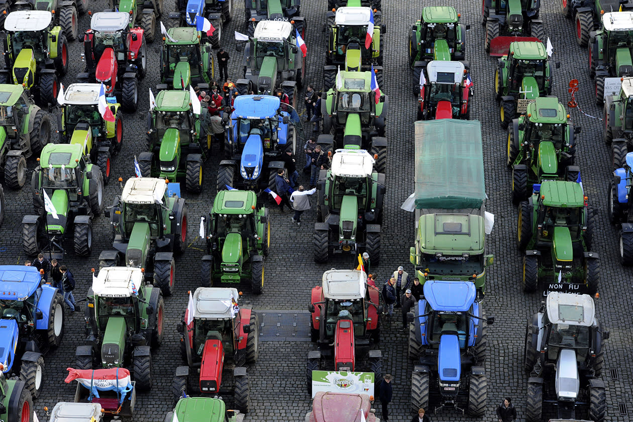European milk farmers park their tractors before driving into the European quarter in Brussels.