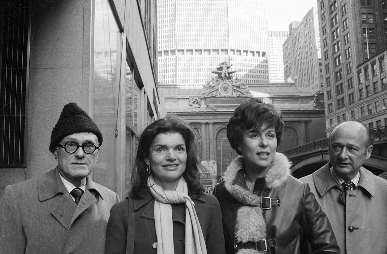 "FILE - In this Jan. 30, 1975, file photo, Jacqueline Kennedy Onassis, center left, and Bess Myerson, center right, walk with architect Philip Johnson, left, and Rep. Ed Koch, right, as they leave New York's Grand Central after holding a news conference for the ""Committee to Save Grand Central Station."" Koch, the combative politician who rescued the city from near-financial ruin during three City Hall terms, has died at age 88. Spokesman George Arzt says Koch died Friday morning Feb. 1, 2013 of congestive heart failure. (AP Photo/Harry Harris, File)"