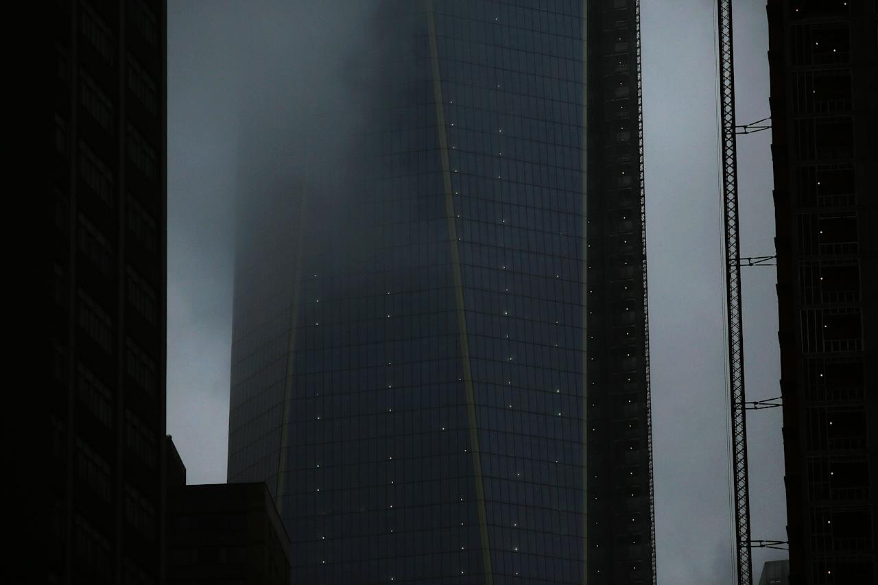 NEW YORK, NY - FEBRUARY 08: The Freedom Tower is shrouded in fog, rain and sleet as Manhattan prepares for a major winter storm on February 8, 2013 in New York City.  New York City and much of the Northeast is expected to get a foot or more of snow through Saturday afternoon with possible record-setting blizzard conditions expected. Heavy snow warnings are in effect from New Jersey through southern Maine.  (Photo by Spencer Platt/Getty Images)