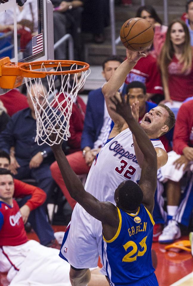 Los Angeles Clippers forward Blake Griffin (32) goes up  against Golden State Warriors forward Draymond Green (23) during the first half of Game 7 of a first-round NBA basketball playoff series, Saturday, May 3, 2014, in Los Angeles.  (AP Photo/Ringo H.W. Chiu)