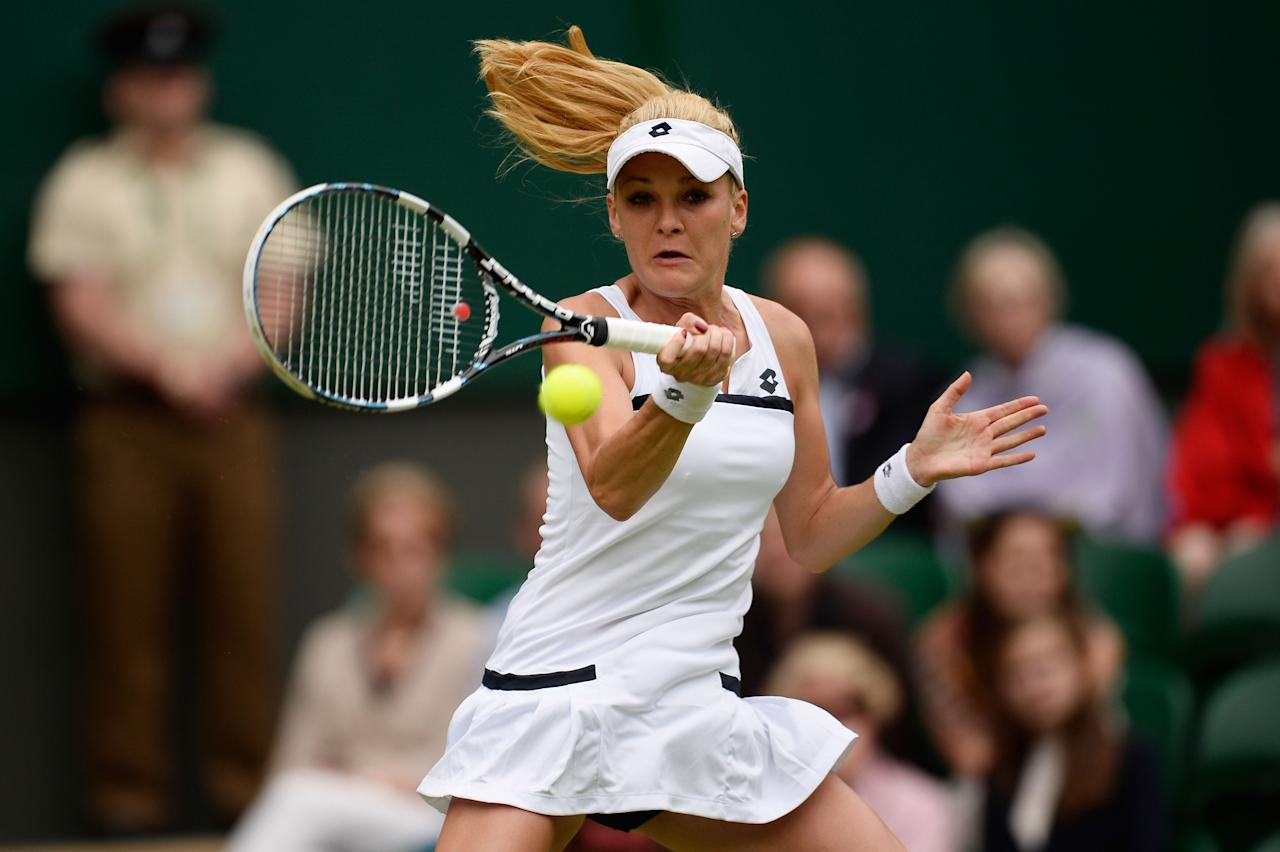 LONDON, ENGLAND - JUNE 27: Agnieszka Radwanska of Poland plays a forehand during the Ladies' Singles second round match against Mathilde Johansson of France on day four of the Wimbledon Lawn Tennis Championships at the All England Lawn Tennis and Croquet Club on June 27, 2013 in London, England. (Photo by Dennis Grombkowski/Getty Images)
