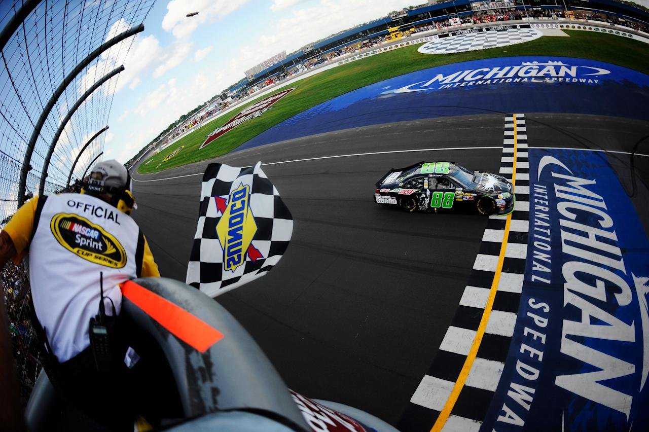 BROOKLYN, MI - JUNE 17:  Dale Earnhardt Jr., driver of the #88 Diet Mountain Dew/TheDarkKnightRises/National Guard/ Chevrolet, crosses the finishline to win the NASCAR Sprint Cup Series Quicken Loans 400 at Michigan International Speedway on June 17, 2012 in Brooklyn, Michigan.  (Photo by Jared C. Tilton/Getty Images)