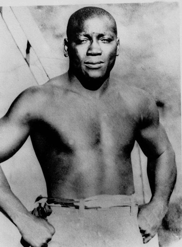 FILE - This undated file shows boxer Jack Johnson, who was born in Galveston, Texas. Johnson became the first African American to win the world champion heavyweight boxing title. He had approximately 113 bouts, only six losses and was inducted into the Boxing Hall of Fame in 1954. Lawmakers are going another round in their fight to get a posthumous presidential pardon for Johnson, who was imprisoned nearly a century ago because of his romantic ties with a white woman.
