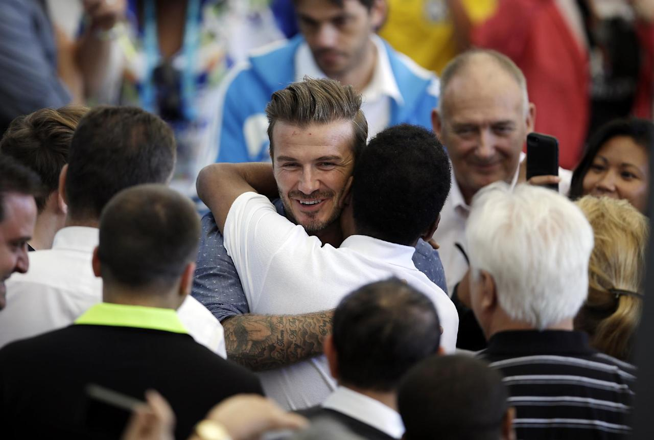 Former English soccer player David Beckham greets Brazilian soccer legend Pele during the World Cup final soccer match between Germany and Argentina at the Maracana Stadium in Rio de Janeiro, Brazil, Sunday, July 13, 2014. (AP Photo/Hassan Ammar)
