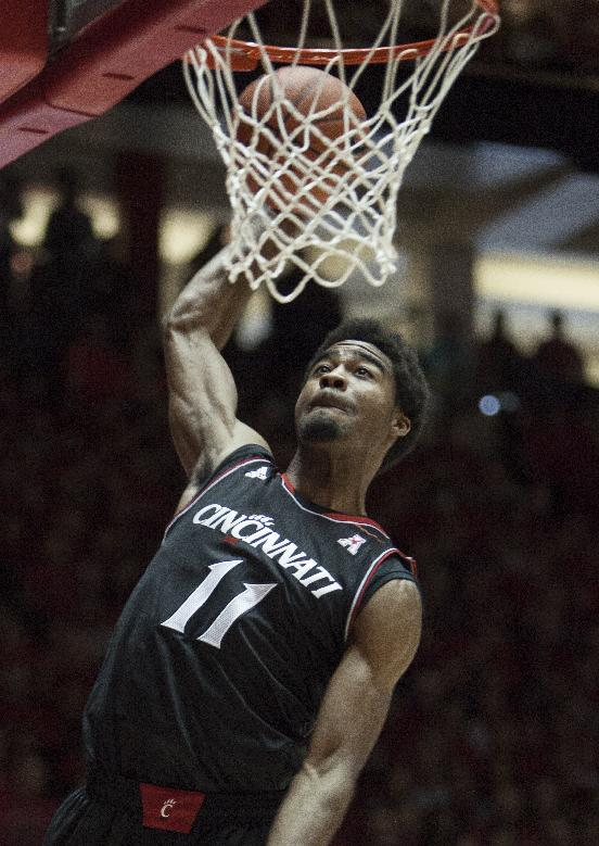 Cincinnati's Jermaine Lawrence dunks the ball during the first half of an NCAA college basketball game against New Mexico, Saturday, Dec. 7, 2013, in Albuquerque, NM