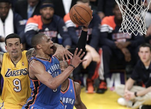 Oklahoma City Thunder's Russell Westbrook is fouled by Los Angeles Lakers' Matt Barnes, left, during the first half in Game 3 of an NBA basketball playoffs Western Conference semifinal in Los Angeles, Friday, May 18, 2012. (AP Photo/Jae C. Hong)