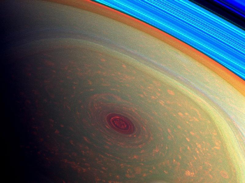 This spectacular, vertigo inducing, false-color image from NASA's Cassini mission highlights the storms at Saturn's north pole. The angry eye of a hurricane-like storm appears dark red while the fast-moving hexagonal jet stream framing it is a yellowish green. (Courtesy: NASA/JPL-Caltech/SSI)