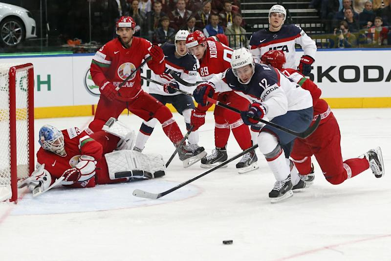 USA forward Kevin Hayes, right, attempts to score during the Group B preliminary round match between Belarus and USA at the Ice Hockey World Championship in Minsk, Belarus, Friday, May 9, 2014