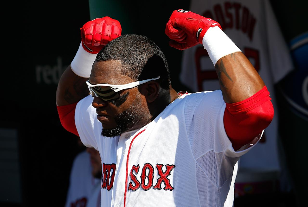 BOSTON, MA - JUNE 29: David Ortiz #34 of the Boston Red Sox displays the Boston Strong gesture before a game with the Toronto Blue Jays inning at Fenway Park on June 29, 2013 in Boston, Massachusetts. (Photo by Jim Rogash/Getty Images)