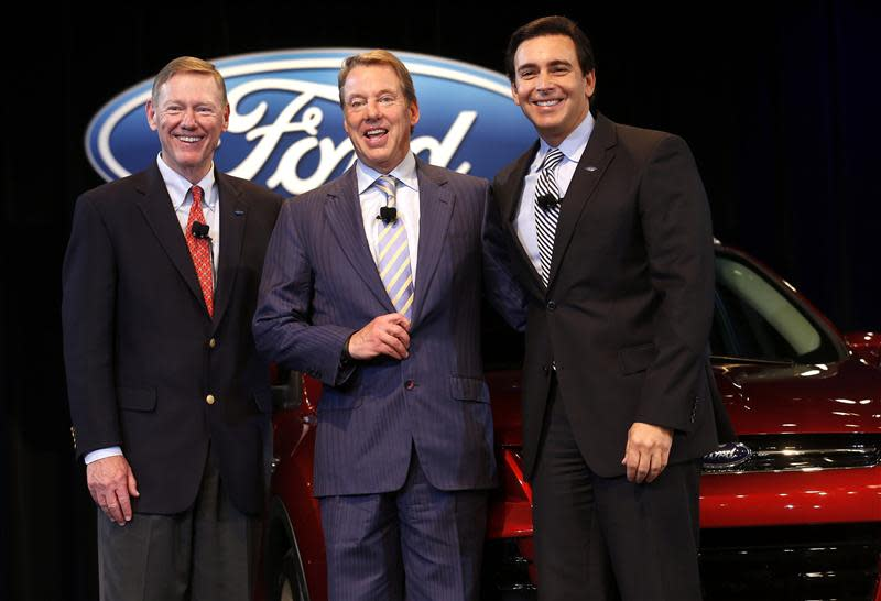 Ford Motor CEO and president Alan Mulally stands with Executive Chairman Bill Ford and COO Mark Fields after announcing Fields will replace Mulally as CEO during a news conference in Dearborn