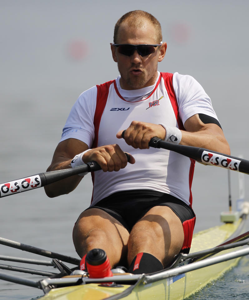 "Norway's Olaf Tufte juggles three jobs: farmer, fireman, and gold medal-winning single-scull rower.  Tufte earns a living by growing food on the family farm and fighting fires.  He took home the silver in Sydney and overcame asthma and injuries to win gold in Beijing.  As if that's not enough, Tufte also hosts the ""Tufte Farmers' Challenge,"" a competition for top Norwegian athletes featuring axe throwing, car-pulling, and tire flipping.  He's a favorite to win in London, but admitted that he's been struggling with health issues and energy levels—can't blame the guy. (Stevanovic/Getty Images)"