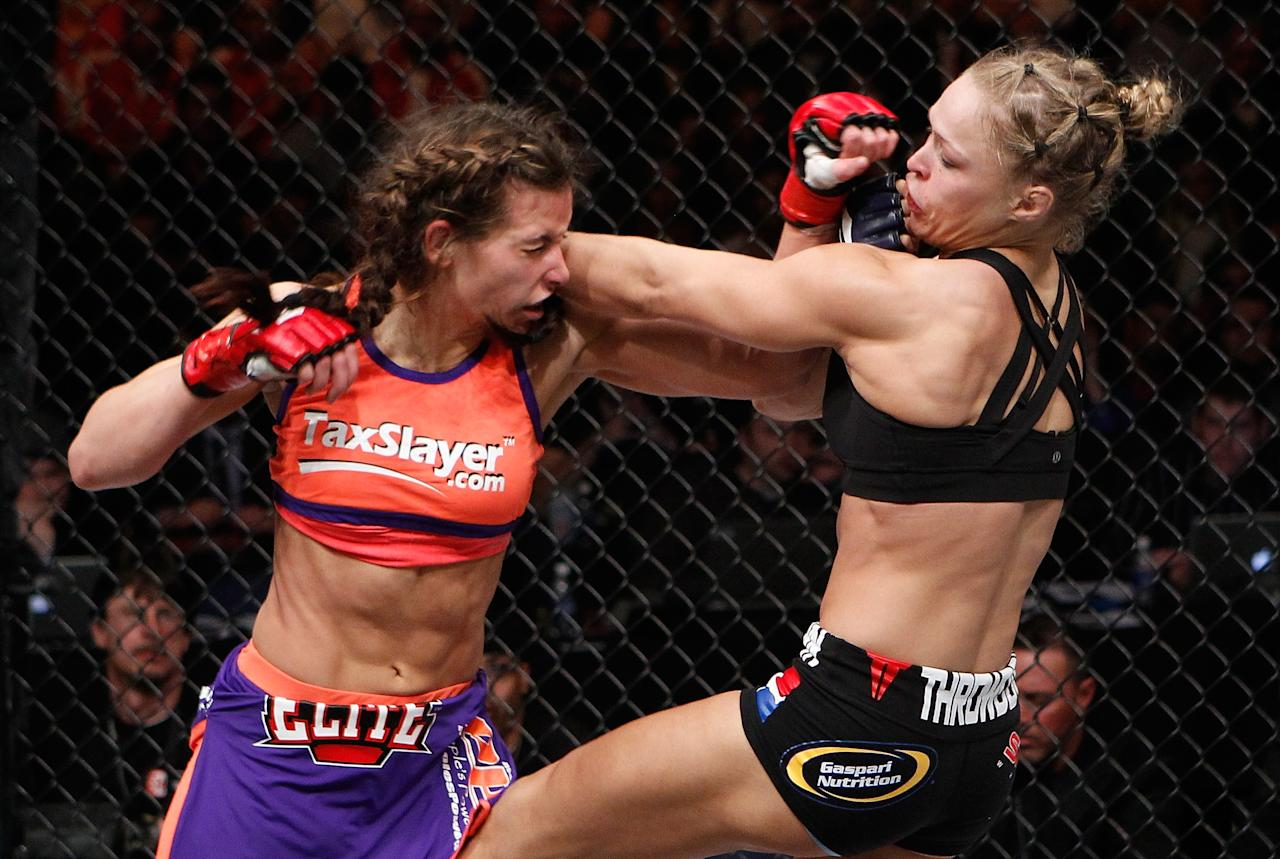 COLUMBUS, OH - MARCH 03:  Miesha Tate (left) punches Ronda Rousey (right) during the Strikeforce event at Nationwide Arena on March 3, 2012 in Columbus, Ohio.  (Photo by Esther Lin/Forza LLC/Forza LLC via Getty Images)