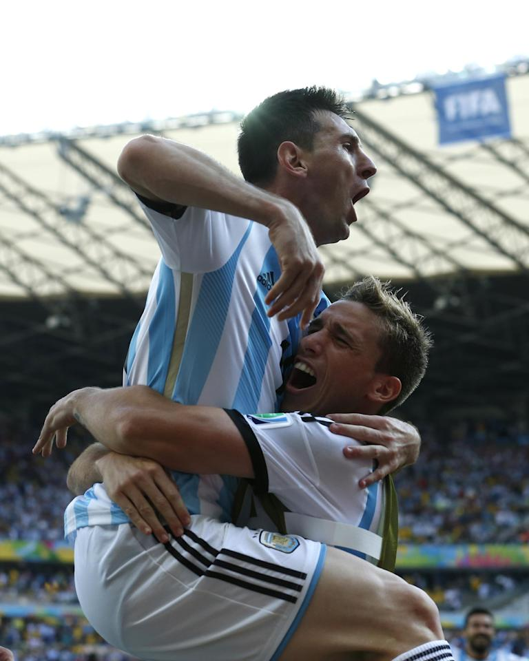 Argentina's Lionel Messi, left, celebrates after scoring during the group F World Cup soccer match between Argentina and Iran at the Mineirao Stadium in Belo Horizonte, Brazil, Saturday, June 21, 2014. Argentina won 1-0. (AP Photo/Jon Super)