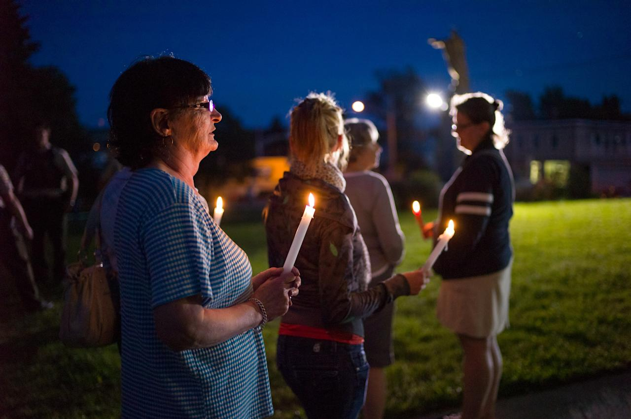 LAC-MEGANTIC, CANADA - JULY 12: Local residents attend a public vigil at the Presbyteres-Eglises July 12, 2013 in Lac-Megantic, Quebec, Canada. A train derailed and exploded into a massive fire that flattened dozens of buildings in the town's historic district, leaving 60 people dead or missing in the early morning hours of July 6. (Photo by Ian Willms/Getty Images)