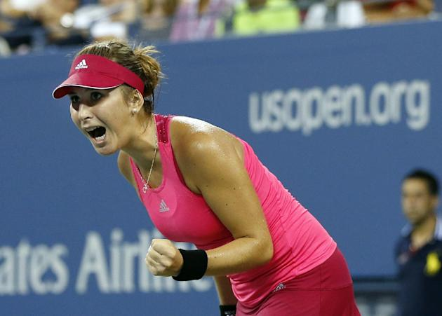 Belinda Bencic, of Switzerland, reacts on her way to her upset victory over Jelena Jankovic, Sunday. (AP Photo/Elise Amendola)