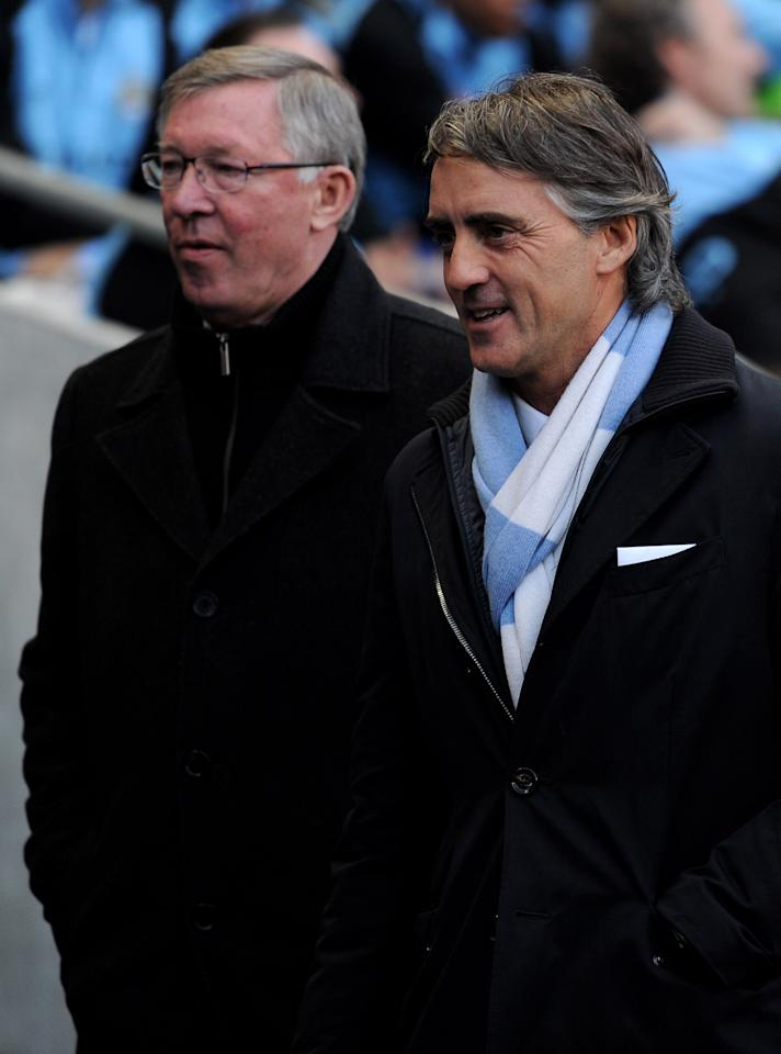 MANCHESTER, ENGLAND - APRIL 30:  Manchester United Manager Sir Alex Ferguson looks on with Manchester City Manager Roberto Mancini (R) prior to the Barclays Premier League match between Manchester City and Manchester United at the Etihad Stadium on April 30, 2012 in Manchester, England.  (Photo by Michael Regan/Getty Images)