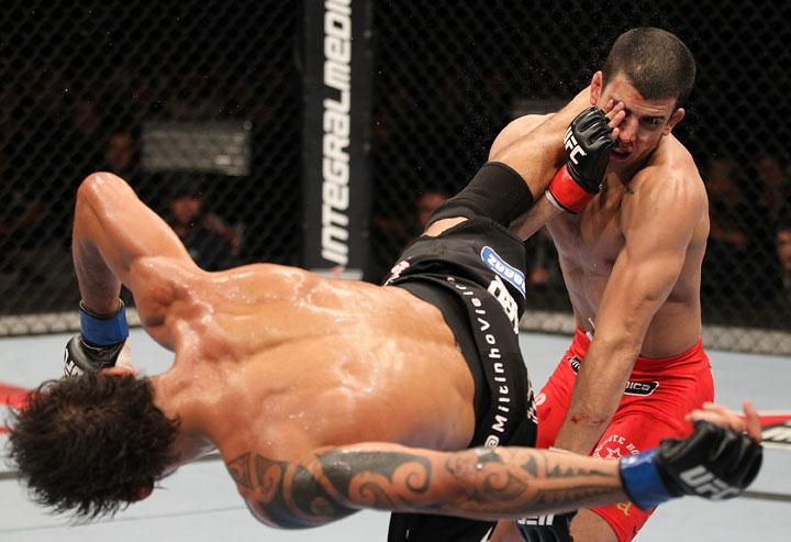 BELO HORIZONTE, BRAZIL - JUNE 23:   (L-R) Milton Vieira delivers a spinning kick to the head of Felipe Arantes  during their UFC 147 featherweight bout at Estadio Jornalista Felipe Drummond on June 23, 2012 in Belo Horizonte, Brazil.