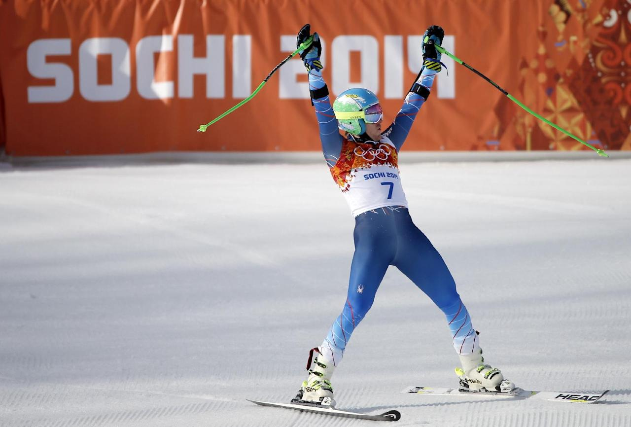United States' Ted Ligety celebrates after winning the gold medal in the men's giant slalom at the Sochi 2014 Winter Olympics, Wednesday, Feb. 19, 2014, in Krasnaya Polyana, Russia.(AP Photo/Christophe Ena)