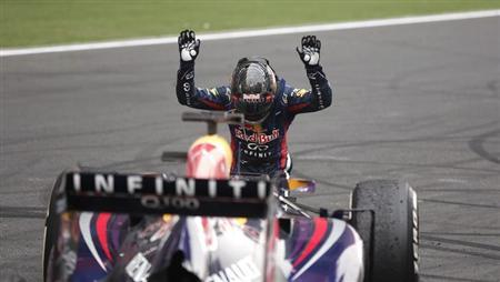 Red Bull Formula One driver Sebastian Vettel of Germany bows down in front of his car after winning the Indian F1 Grand Prix at the Buddh International Circuit in Greater Noida, on the outskirts of New Delhi, October 27, 2013. REUTERS/Adnan Abidi