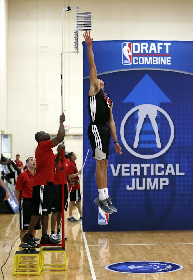 Aaron Gordon, from Arizon, makes his second attempt in running vertical jump at the 2014 NBA basketball draft combine Friday, May 16, 2014, in Chicago. Gordon topped out at 12 feet and the measuring pole was raised on stools for a higher reading. (AP Photo/Charles Rex Arbogast)