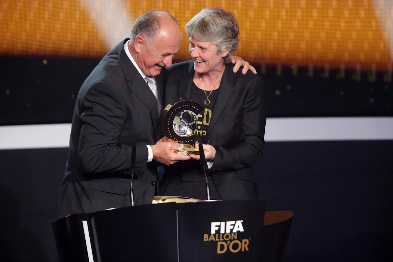 ZURICH, SWITZERLAND - JANUARY 07:  Pia Sudhage, women's coach of United States receives the FIFA World Coach of Women's Football 2012 trophy by Felipe Scolari (L) at Congress House on January 7, 2013 in Zurich, Switzerland.  (Photo by Christof Koepsel/Getty Images)